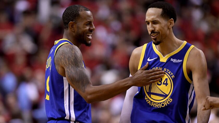 Golden State Warriors forward Andre Iguodala (9) and teammate Shaun Livingston (34) celebrate their