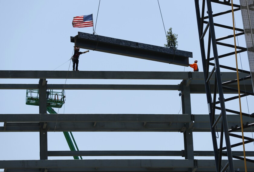 The last steel beam was raised at Aztec Stadium for topping-out ceremony, which marked the end of that phase of construction.