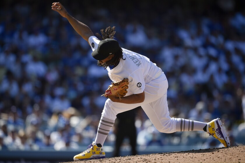 Kenley Jansen delivers during the ninth inning of the Dodgers' 2-1 victory over the New York Yankees on Saturday.