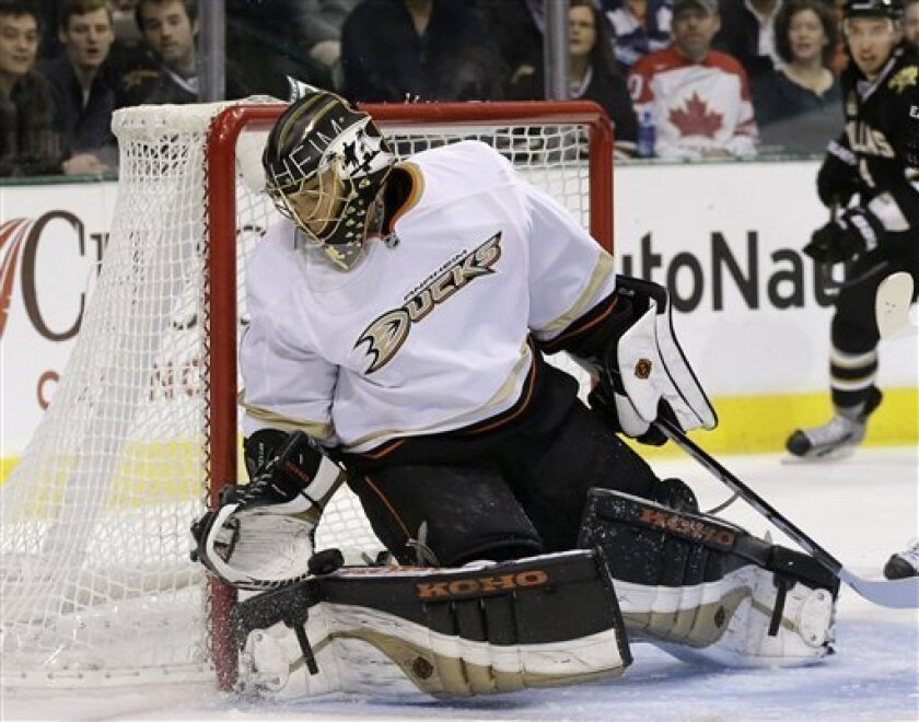 Anaheim Ducks goalie Jonas Hiller (1), of the Czech Republic, defends against a shot by the Dallas Stars in the first period of an NHL hockey game on Thursday, March 14, 2013, in Dallas. (AP Photo/Tony Gutierrez)