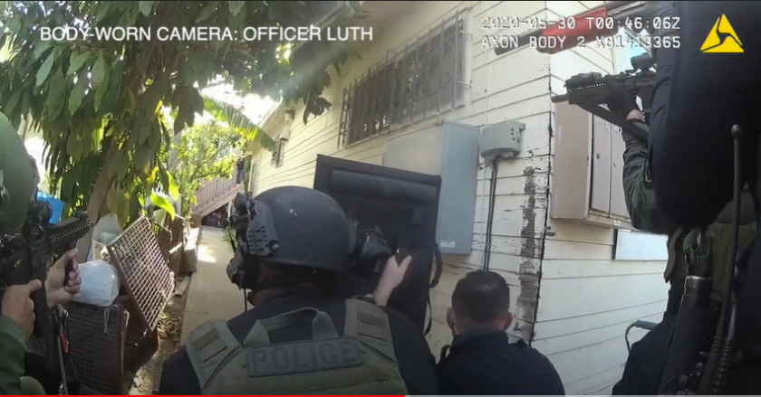 San Diego police released body camera video of officers fatally shooting a homicide suspect in City Heights on May 29.