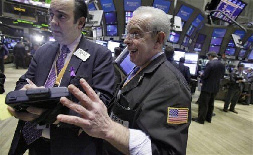 Traders Robert Maher, left, and Anthony Alvarino work on the floor of the New York Stock Exchange Tuesday, Feb. 9, 2010. (AP Photo/Richard Drew)