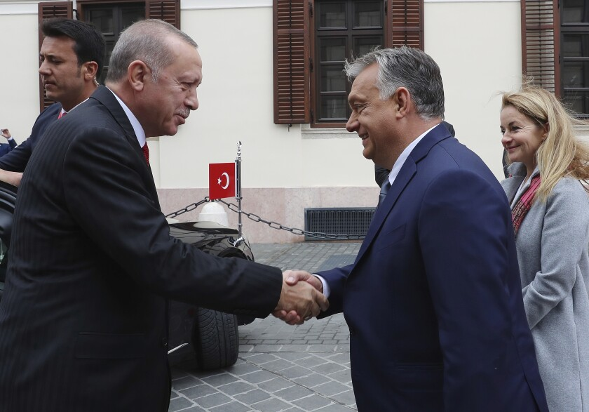 Hungarian Prime Minister Viktor Orban, right, welcomes Turkish President Recep Tayyip Erdogan before a meeting, in Budapest, Hungary, Thursday, Nov. 7, 2019. Erdogan is on a one-day state visit to Hungary. (Presidential Press Service via AP, Pool)