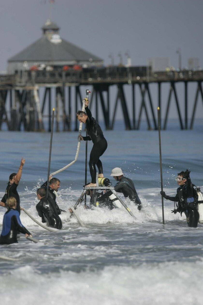 Scientists from Scripps Institution of Oceanography set up monitoring equipment in the surf zone. Devices called &#8220;drifters&#8221; and dye will be used to simulate the flow of pollution in the ocean. The tests will give researchers an idea how quickly contaminants spread. <em> &#8201; John Gib