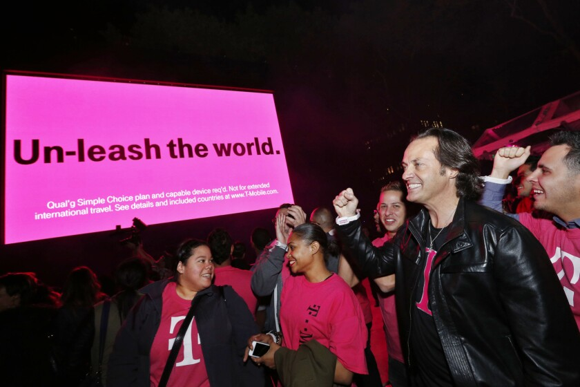 T-Mobile's John Legere, right, will step down, and Chief Operating Officer Mike Sievert will take over as CEO on May 1, the company announced.