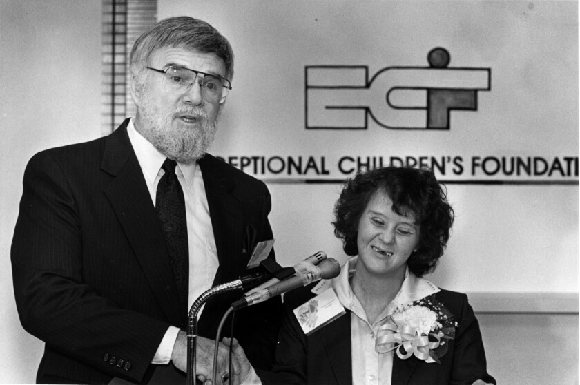 Robert Shushan, executive director of the Exceptional Children's Foundation, celebrates with Terry Westbrook, who was chosen to accept a national award honoring the organization for the developmentally disabled, in 1988.