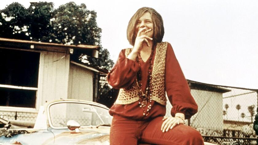 Janis Joplin with her Porsche
