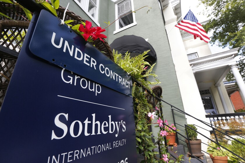 In this Aug. 16, 2019, photo an under contract sign is displayed by a home in Richmond, Va. On Thursday, Sept. 26, the National Association of Realtors releases its August report on pending home sales, which are seen as a barometer of future purchases. (AP Photo/Steve Helber)