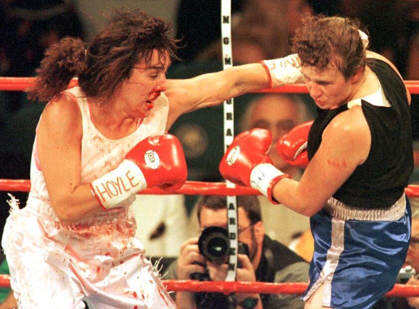 Christy Martin, left, fights Andrea DeShong