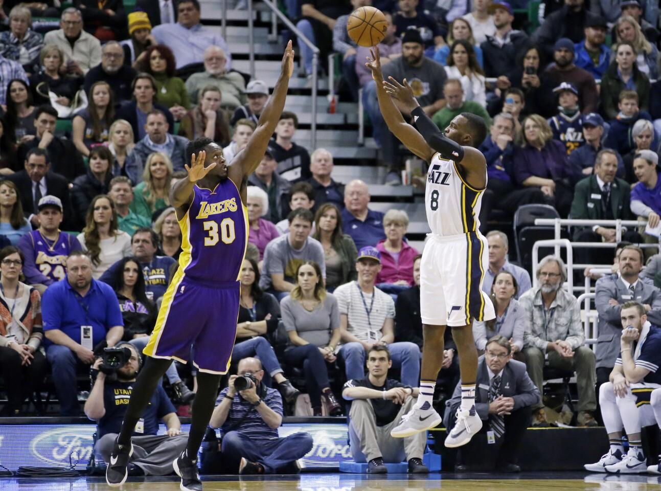 Utah Jazz guard Shelvin Mack (8) shoots over Lakers forward Julius Randle (30) during the second quarter.