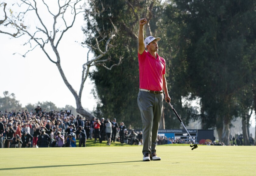 Adam Scott celebrates after winning the Genesis Invitational at Riviera Country Club in Pacific Palisades on Sunday.
