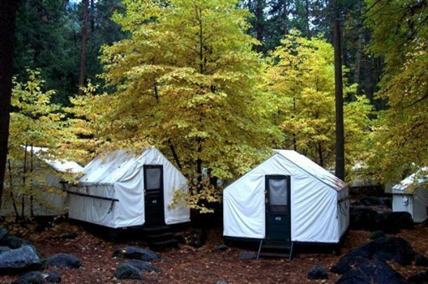 In this undated photo provided by DNC Parks and Resorts at Yosemite, Inc., are tent cabins in the fall at Yosemite National Park in California. Yosemite officials are expanding their efforts notify visitors to a complex of tent cabins who may have been exposed to a rare but potentially deadly roden