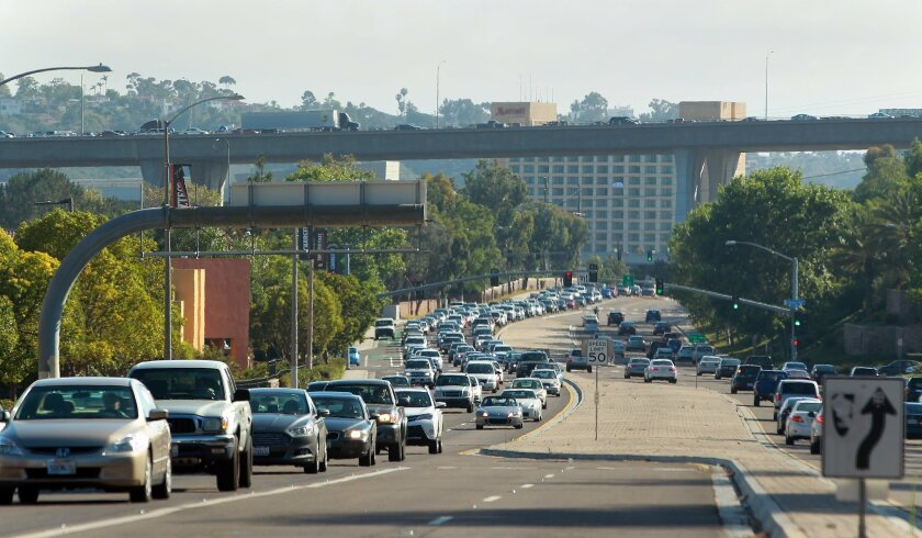 Traffic flows east on Friar's Road in Mission Valley as cars head toward San Diego's Qualcomm Stadium with the Interstate 805 overpass in the background.
