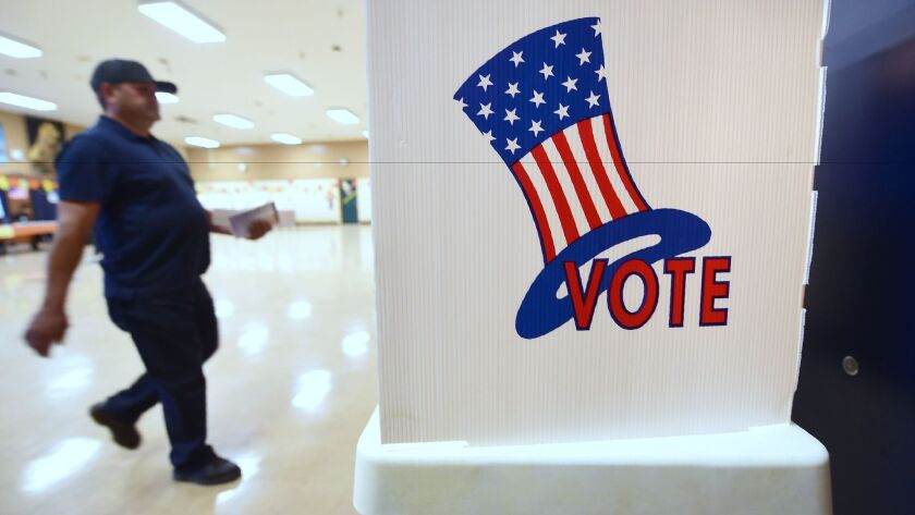 A voter arrives at a polling place in Boyle Heights on Nov. 8.