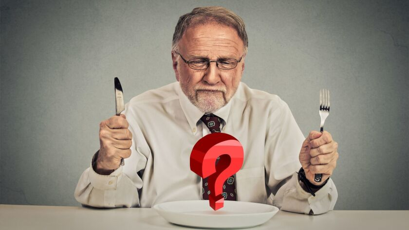 Senior man choosing meal