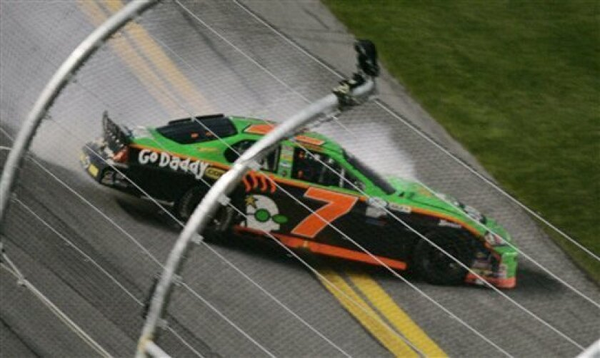 Driver Danica Patrick slides through the tri-oval after losing control of her car during the Lucas Oil Slick Mist 200 ARCA series auto race at the Daytona International Speedway in Daytona Beach, Fla., Saturday, Feb. 6, 2010. (AP Photo/David Graham)