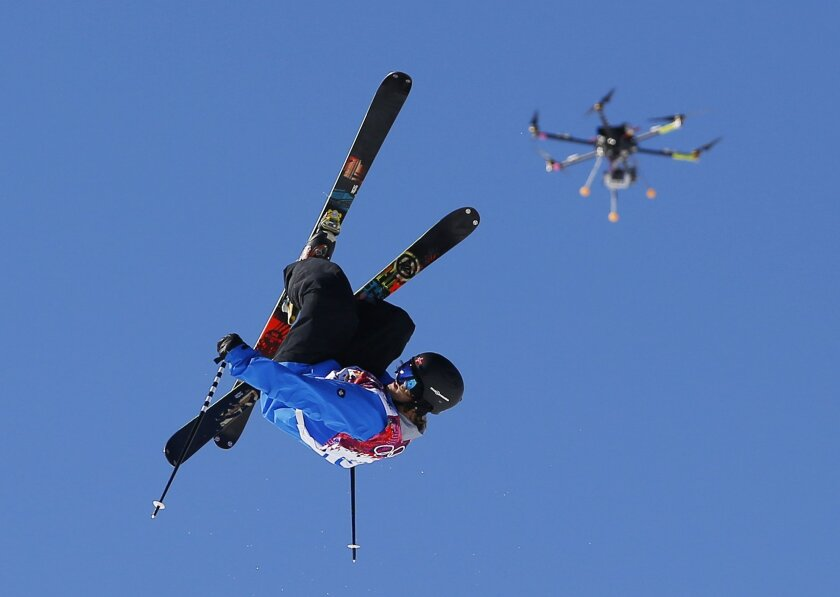 FILE- In this Feb. 13, 2014, file photo, a drone camera follows Norway's Aleksander Aurdal during the men's ski slopestyle final at the Rosa Khutor Extreme Park, at the 2014 Winter Olympics in Krasnaya Polyana, Russia. The Winter X Games is, for the first time, using drones, to enhance its coverage