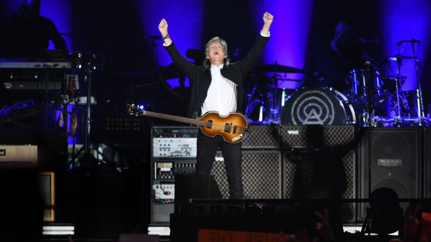 Paul McCartney performs to a sold-out crowd Saturday at Dodger Stadium, where he was joined near the end of the show by his former bandmate in the Beatles, drummer Ringo Starr.