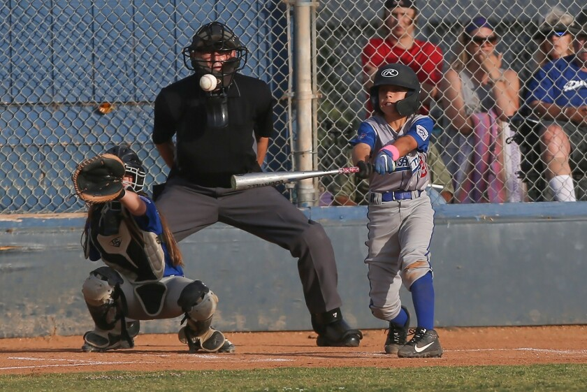 Costa Mesa Dodger's batter Sawyer Atkinson belts a double in a District 62 Tournament of Champions M