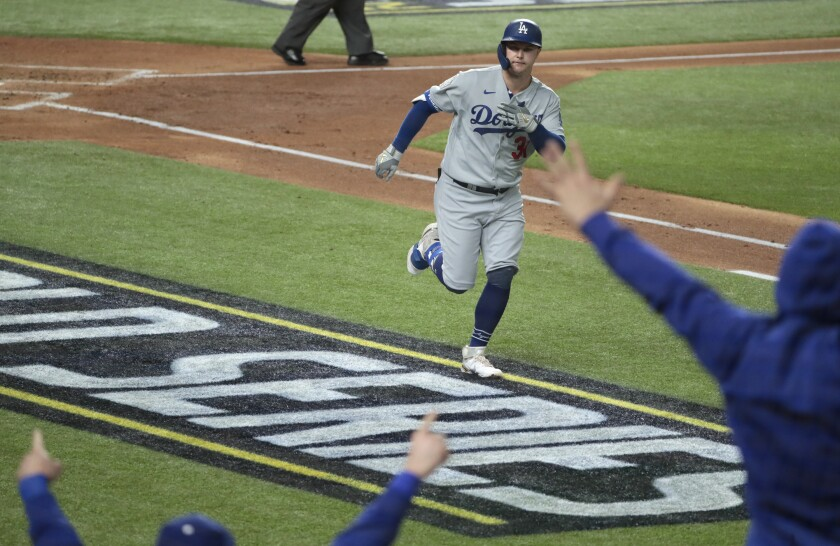 Dodgers left fielder Joc Pederson celebrates after hitting a home run against the Tampa Bay Rays.
