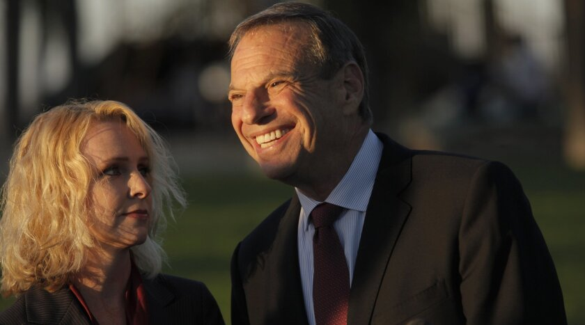 Mayor Bob Filner and fiancee Bronwyn Ingram at Trolley Barn Park in University Heights in happier days. She announced July 8 they had split up.