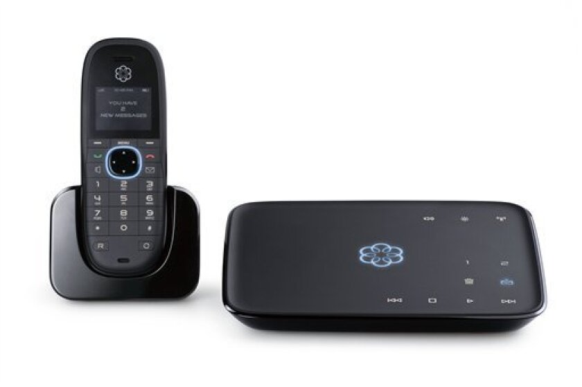 In this product image provided by Ooma, the Ooma Telo is displayed, right, with an optional cordless handset. The Ooma Telo is a fully integrated home phone solution that works through the Internet giving you free calls anywhere in the U.S.(AP Photo/Ooma)
