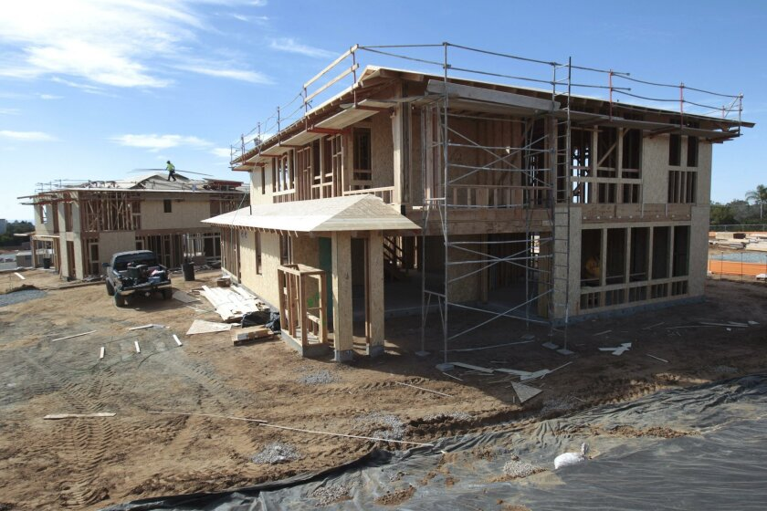 CARLSBAD, February 10, 2016 | Two model homes under construction at Lanai by Shea Homes, a twenty home development in Carlsbad.