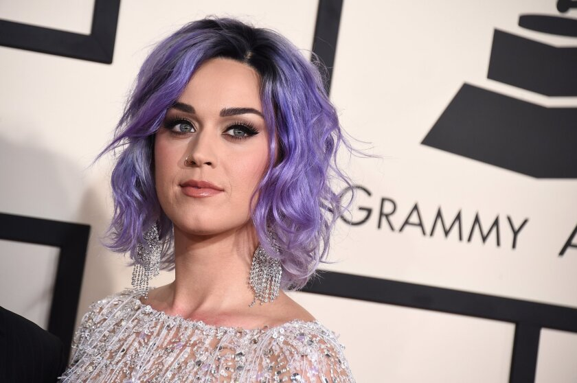FILE - In this Feb. 8, 2015 file photo, Katy Perry arrives at the 57th annual Grammy Awards at the Staples Center in Los Angeles. A Los Angeles judge is scheduled to hear arguments on Thursday, July 30, 2015, about who has the right to sell a hilltop convent that is the subject of competing offers from pop superstar Perry and a local businesswoman. The dispute has pitted Los Angeles' Catholic archbishop against an order of elderly nuns with only five surviving members, at least two of whom oppose selling their former home to Perry. (Photo by Jordan Strauss/Invision/AP, File)