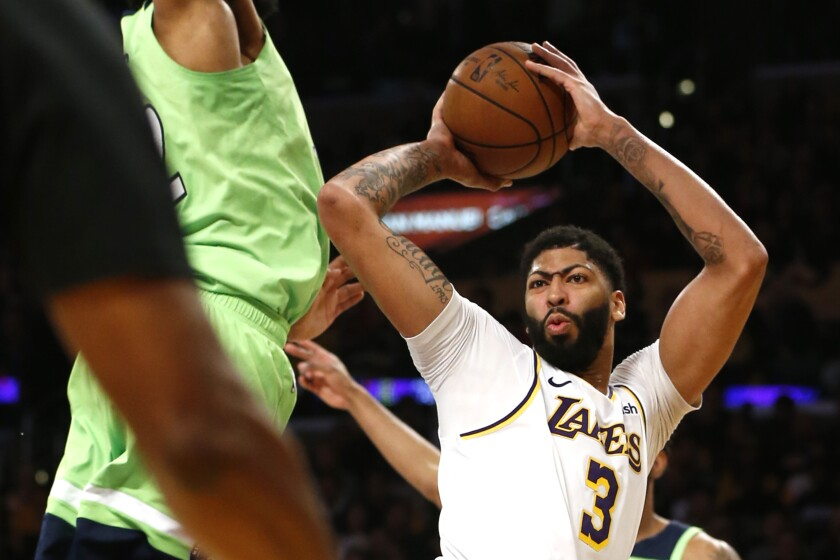 Lakers star Anthony Davis takes a shot against the Timberwolves.