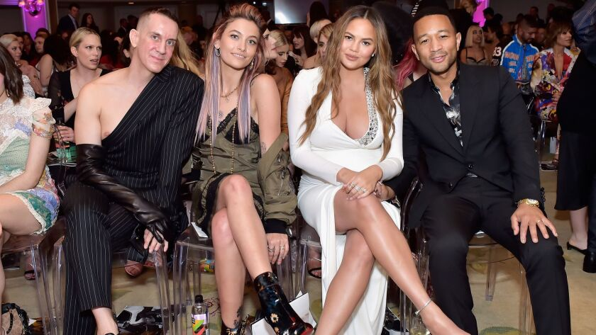 Honoree Jeremy Scott, from left, Paris Jackson, Chrissy Teigen and John Legend add to the style of the Daily Front Row's fourth annual Fashion Los Angeles Awards. The event was at the Beverly Hills Hotel in Beverly Hills on Sunday.