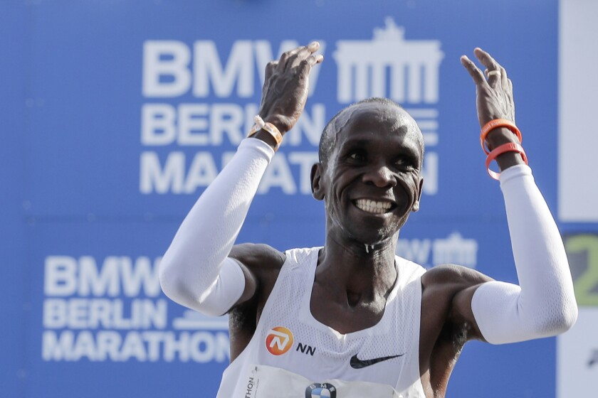 Eliud Kipchoge celebrates winning the 45th Berlin Marathon in Berlin, Germany, Sunday, Sept. 16, 2018. Eliud Kipchoge set a new world record in 2 hours 1 minute 39 seconds. (AP Photo/Markus Schreiber)