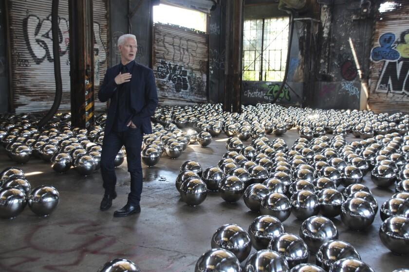 """Klaus Biesenbach at the installation """"Rockaway! 2018: Narcissus Garden"""" by artist Yayoi Kusama."""