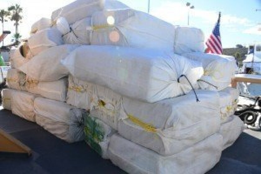 Several bales of marijuana seized from a panga sit on the deck of the Coast Guard Cutter Edisto Dec. 10 before being transferred over the San Diego Marine Task Force at Naval Base Point Loma. The 30-foot panga was intercepted approximately 155 miles south of San Diego. (U.S. Coast Guard photo by Petty Officer 3rd Class Connie Gawrelli)