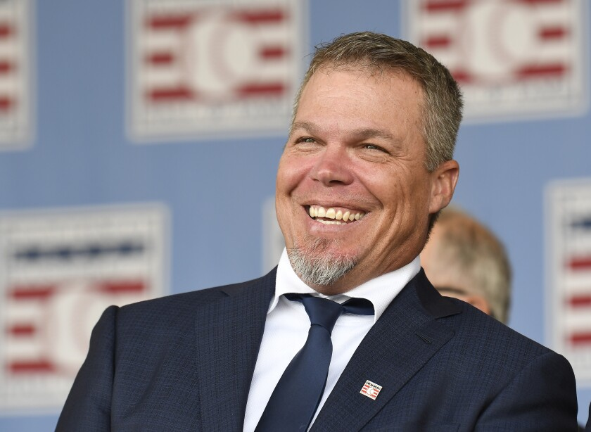 FILE - In this July 29, 2018, file photo, National Baseball Hall of Fame inductee Chipper Jones reacts during an induction ceremony at the Clark Sports Center in Cooperstown, N.Y. Chipper Jones has joined the ESPN lineup. The former Atlanta Braves star will work as a major league analyst, primarily on weeknight and holiday games. He'll debut on opening day when San Francisco plays at Dodger Stadium on March 26.(AP Photo/Hans Pennink, File)