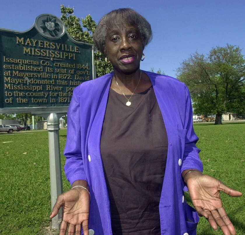 File - In this April 27, 2001 file photo, Mayersville, Miss., Mayor Unita Blackwell stands beside a historical marker describing the establishment of the community in the Delta. Blackwell, a civil rights activist who was the first African American woman to win a mayor's race in Mississippi died Monday, May 13, 2019 in Ocean Springs, Miss. She was 86.