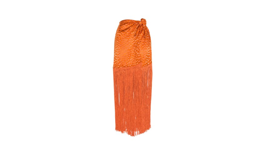 The Oriana, a jacquard chiffon wrap style skirt with fringe detail, by LPA. $198 at revolve.com Cre