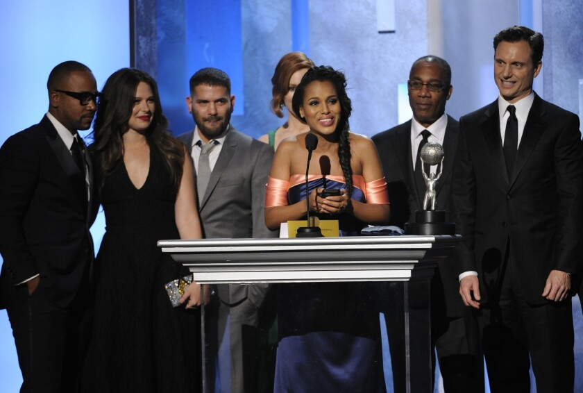 """Columbus Short, left, Katie Lowes, Guillermo Díaz, Darby Stanchfield, Kerry Washington, Joe Morton and Tony Goldwyn accept the award for outstanding drama series for """"Scandal"""" at the 45th NAACP Image Awards."""