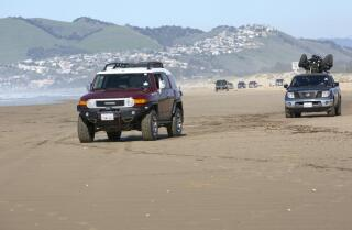 State agencies feud over off-roading along seaside dunes