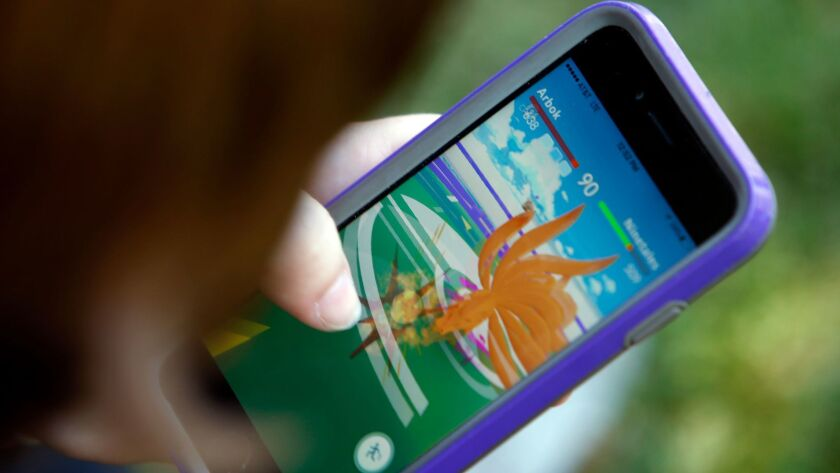 """A """"Pokemon Go"""" player engages in battle shortly after the game was released in July 2016."""