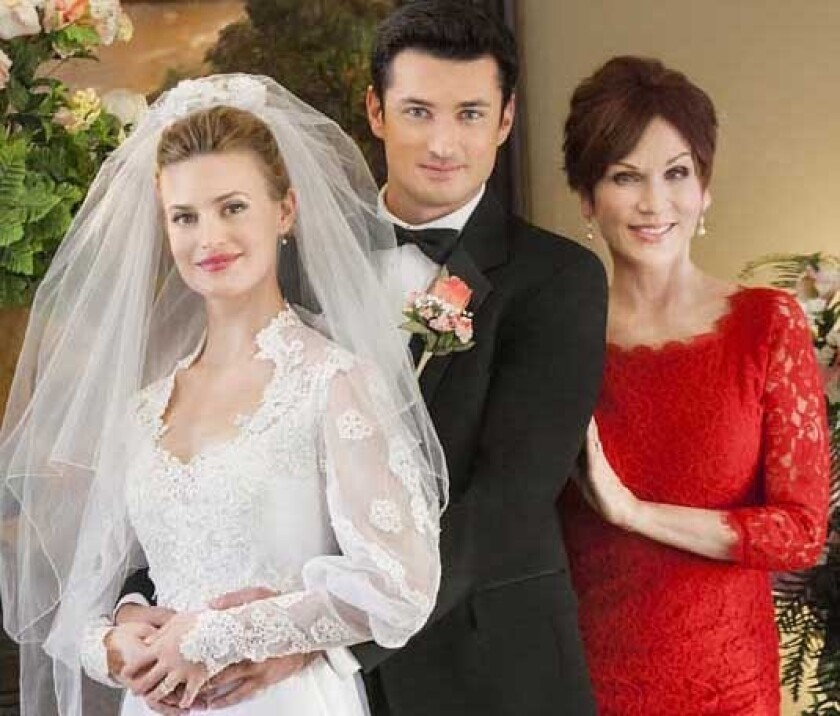 """Brooke D'Orsay, left, Wes Brown and Marilu Henner in """"June in January"""" on Hallmark."""