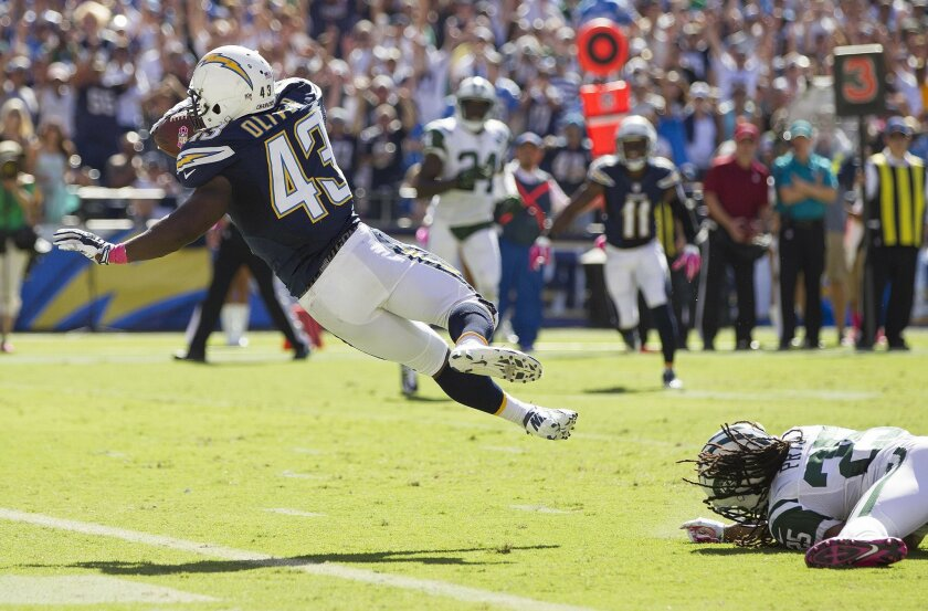 Chargers running back Branden Oliver beats New York Jets free safety Calvin Pryor (25) on a 15-yard touchdown run in the second quarter.