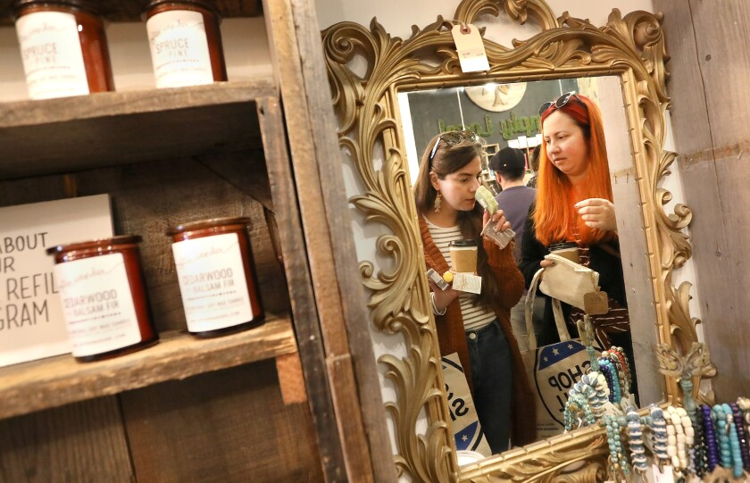 Arlene Camargo, left, and Jenny Armer shop at Simply Local, a store in North Park taking part in Small Business Saturday.