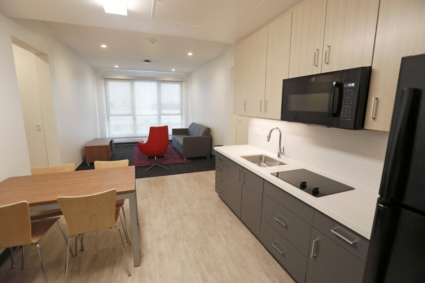 The dormitory of the K sleeps four students in a two-bedroom suite, with a kitchenette that includes an electric stove, built-in microwave, and full-size refrigerator.
