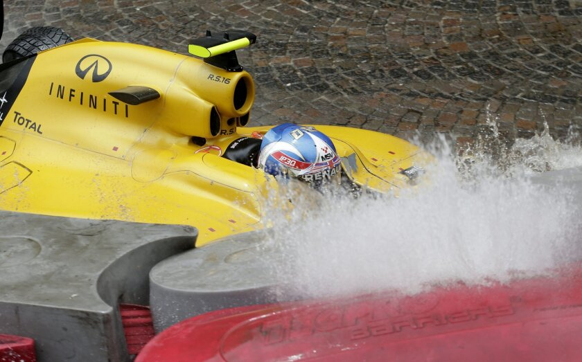 Renault driver Jolyon Palmer of Britain crashes into a safety barrier during the Formula One Grand Prix at the Monaco racetrack in Monaco, Sunday, May 29, 2016. (AP Photo/Petr David Josek)