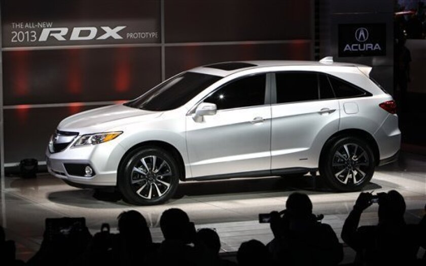 The 2013 Acura RDX crossover sport utility vehicle prototype debuts at the North American International Auto Show in Detroit, Monday, Jan. 9, 2012. (AP Photo/Paul Sancya)