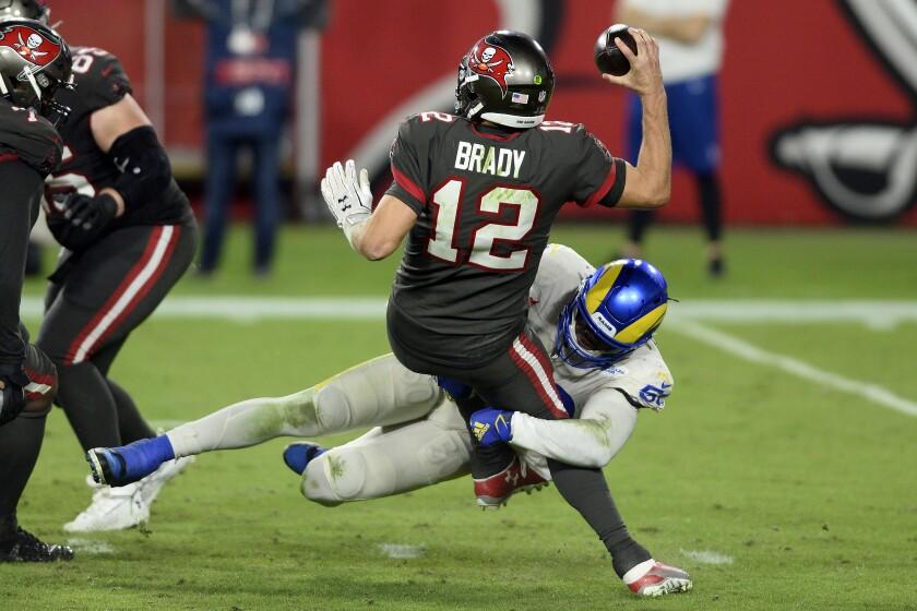 Los Angeles Rams outside linebacker Samson Ebukam (50) sacks Tampa Bay Buccaneers quarterback Tom Brady (12) during the second half of an NFL football game Monday, Nov. 23, 2020, in Tampa, Fla. (AP Photo/Jason Behnken)