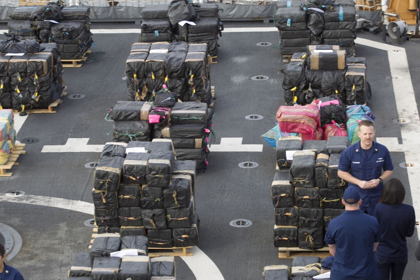 The flight deck of the USCG Cutter Stratton, which participated in the operation, had the drugs staged for unloading.