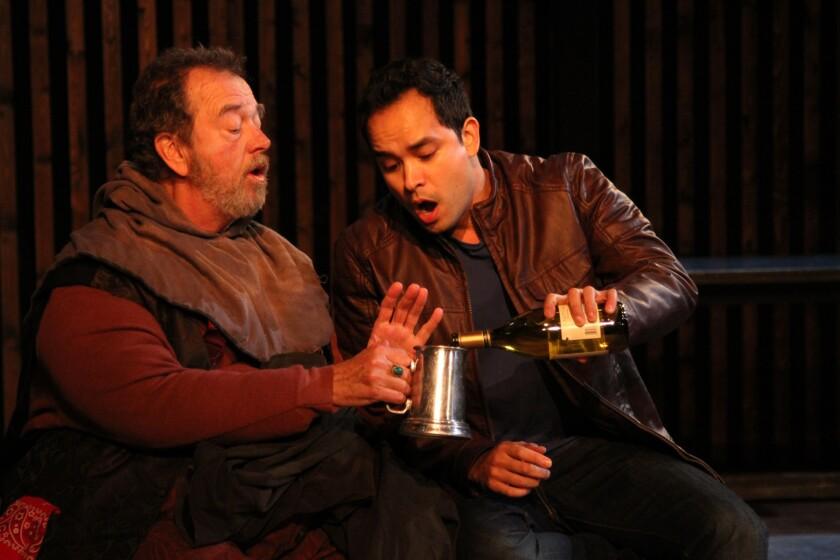 Falstaff (Gregory Itzin), left, regales his protégé Prince Hal (Ramón de Ocampo) with his exaggerated exploits.