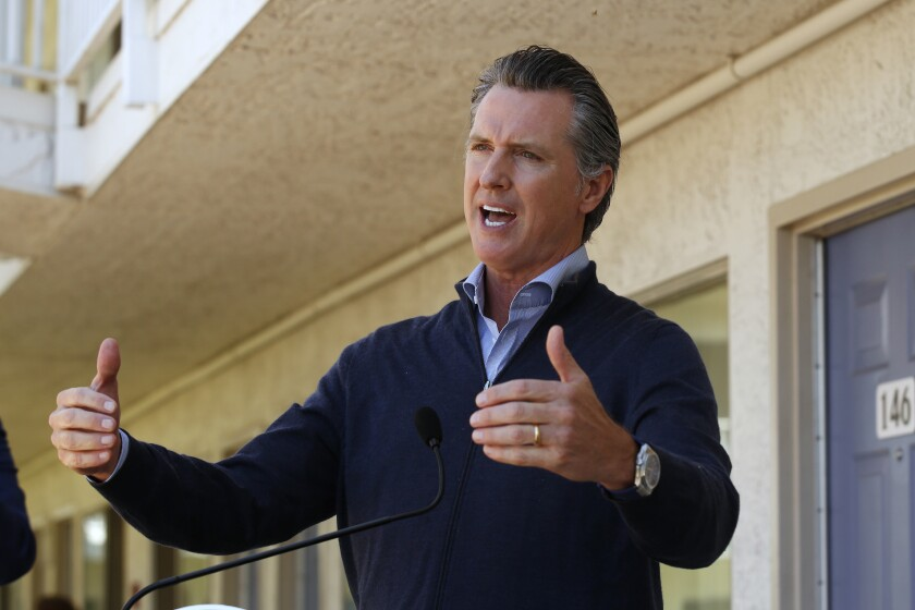"Gov. Gavin Newsom gives an update on the state's initiative to provide housing for homeless Californians to help stem the coronavirus, during a visit to a Motel 6 participating in the program in Pittsburg, Calif., Tuesday, June 30, 2020. Newsom announced that more than 15,000 rooms have been acquired and more than 14,000 people have been given places to stay statewide under the Project Room key program started in April. The governor also said he plans to announce on Wednesday plans to ""toggle back"" the states stay-at-home order. (AP Photo/Rich Pedroncelli, Pool)"