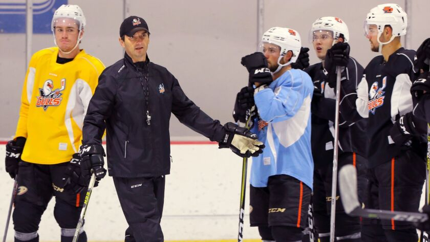 Coach Dallas Eakins instructs the Gulls during practice last week in Poway.
